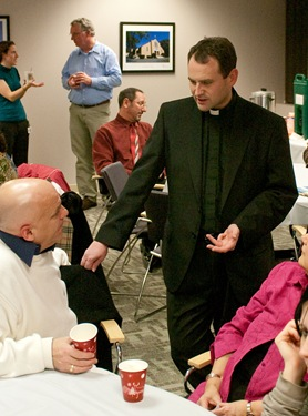 Leaders of the youth and young adult ministry of the Archdiocese of Boston gather at the Pastoral Center for an evening of networking and collaboration led by father Matt Williams of the Office for the New Evangelization of Youth and Young Adults.<br /> Pilot photo/ Neil W. McCabe