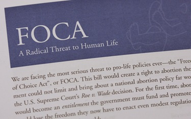 A close-up view shows literature used in a campaign against the Freedom of Choice Act at the office of the National Committee for a Human Life Amendment in Washington Jan. 26. Staff in the office were shipping boxes of postcards to dioceses and others as part of a national campaign against FOCA. (CNS photo/Paul Haring) (Jan. 26, 2009) See POSTCARDS Jan. 23, 2009.
