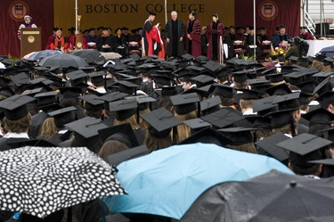 Daniel J. Harrington, SJ stands on stage about to receive his degree of Doctor of Humane Letters at the Boston College 2009 commencement exercises on M 5/18. Photo Lee Pellegrini
