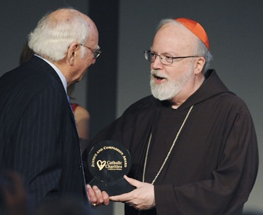 Cardinal Sean P. O'Malley awards A. Raymond Tye, president of The Ray Tye Medical Aid Foundation and Chairman Emeritus of United Liquors Ltd., the 2009 Justice and Compassion Award during the Spring Celebration 2009 at the John F. Kennedy Presidential Library and Museum, Thursday, May 21, 2009 in Boston. (Photo/Lisa Poole)