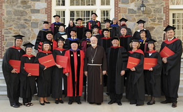 Cardinal Sean P. O'Malley, graduates and others pose following commencement of Master of Arts in Ministry at St. John's Chapel at St. John's Seminary, Wednesday, May 20, 2009 in Brighton, Mass. (Photo by Lisa Poole)