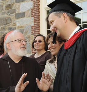 Cardinal Sean P. O&#39;Malley speaks to graduate Andreas Widmer following commencement of Master of Arts in Ministry at St. John&#39;s Chapel at St. John&#39;s Seminary, Wednesday, May 20, 2009 in Brighton, Mass. (Photo by Lisa Poole)