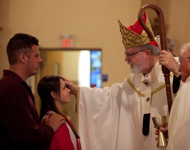 Cardinal Seán confirms the confirmation class at St. George Church in Framingham this past Sunday.
