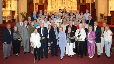 Couples celebrating their 25th and 50th wedding anniversaries participate in a special Mass with Cardinal Sean P. OMalley at the Cathedral of the Holy Cross June 7, 2009. Photo by Gregory L. Tracy, The Pilot 