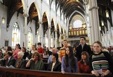 People stand to be honored during the altar server appreciation mass at the Cathedral of the Holy Cross, Boston, Saturday, Oct. 31, 2009. (Photo/Lisa Poole)