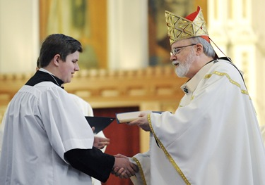 Cardinal Sean O'Malley gives William Haughey the Pope John Paul II award during an altar server appreciation mass at the Cathedral of the Holy Cross, Boston, Saturday, Oct. 31, 2009. (Photo/Lisa Poole)