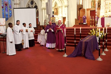 Cardinal Sen P. OMalley celebrates a memorial Mass at the Cathedral of the Holy Cross March 7, 2010 for the victims of the Jan. 12 earthquake in Haiti. Pilot photo by Gregory L. Tracy