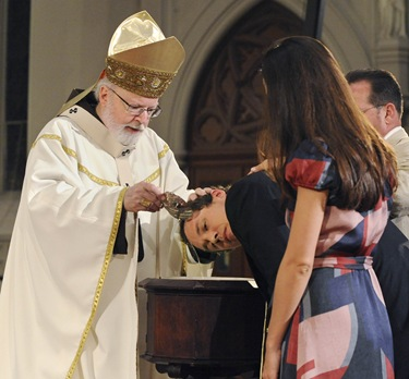Baptism during an Easter Vigil with Sen Cardinal OMalley at the Cathedral of the Holy Cross in Boston, Saturday, April 3, 2010.  (Photo/Lisa Poole)