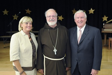 Cardinal Sean P. O&#39;Malley poses with the Connors during an awards night at the Pope John Paul II Catholic Academy in Dorchester, Wednesday, June 2, 2010. (Photo/Lisa Poole)