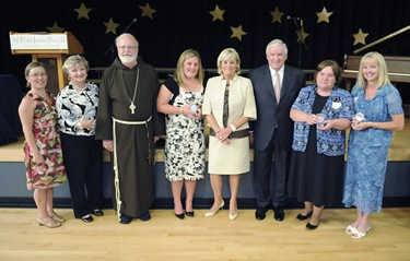 Cardinal Sean P. O'Malley and the Connors pose with award recipients following an awards night at the Pope John Paul II Catholic Academy in Dorchester, Wednesday, June 2, 2010. (Photo/Lisa Poole)