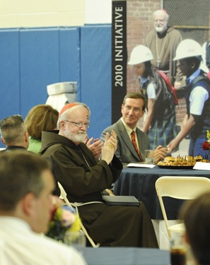 Cardinal Sean P. O'Malley claps during an awards night at the Pope John Paul II Catholic Academy in Dorchester, Wednesday, June 2, 2010. (Photo/Lisa Poole)