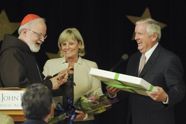 Cardinal Sean P. O&#39;Malley honors the Connors during an awards night at the Pope John Paul II Catholic Academy in Dorchester, Wednesday, June 2, 2010. (Photo/Lisa Poole)