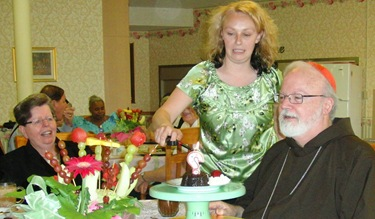 CJC_22 JEnnifer lighting birthday candle for Cardinal O'Malley Brockton 062710 ED-ed