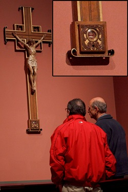 Men venerate the relic of true cross in chapel of Boston's Cathedral of the Holy Cross in April. The reliquary containing the piece of Christ's cross, shown in detail in the inset, was discovered stolen July 1, 2010.  Pilot file photo by Gregory L. Tracy