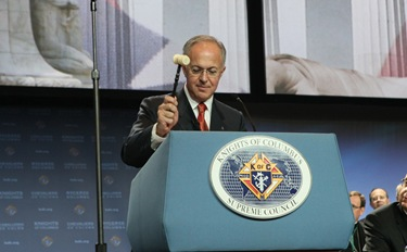 Using a gavel that belonged to the founder of the Knights of Columbus, Father Michael J. McGivney, Supreme Knight Carl A. Anderson officially commences the opening business session of the 128th Supreme Convention Aug. 3 in Washington, D.C.