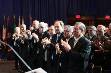 Members of the Supreme Board of Directors and other Knights of Columbus leaders give a standing ovation following the supreme knight's annual report.