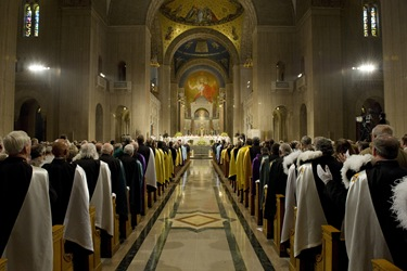 Fourth Degree Knights stand at the end of the pews, as thousands of Knights and their families participate in Mass at the Basilica of the National Shrine of the Immaculate Conception.