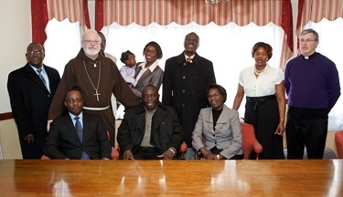 Visit by leader of the Ugandan Catholic community in Boston, March 13, 2011. Photo by Gregory L. Tracy/ The Pilot