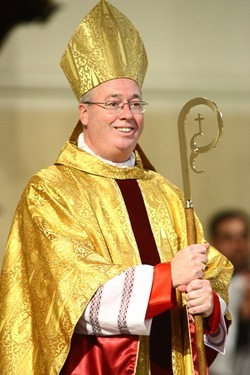 Bishop Christopher J. Coyne, a former priest of the Archdiocese of Boston, receives applause from those assembled for his ordination as the Auxiliary Bishop of Indianapolis at St. John the Evangelist Church in Indianapolis on Wednesday, March 2, 2011, after receiving his miter, crosier and Episcopal ring.  The last Auxiliary Bishop for the Archdiocese of Indianapolis was ordained in 1933.  CNS photo by Bob Nichols.