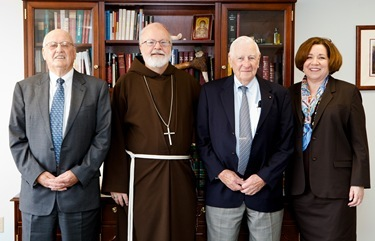 Superintendent of Schools Mary Grassa O'Neill and Cardinal O'Malley meet with Jack and Fred Sheehan May 9, 2011. Pilot photo/ Gregory L. Tracy
