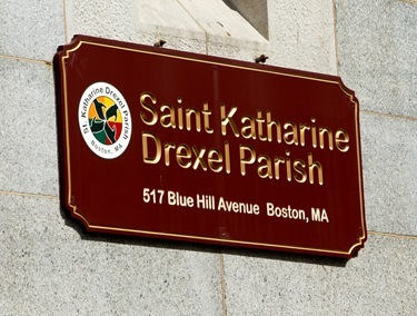 Employees from the acrhdiocese&#39;s Pastoral Center help clean and beautify St. Katharine Drexel Parish, May 25, 2011. Pilot photo by Gregory L. Tracy
