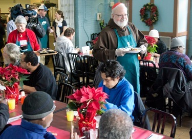 Cardinal Seán P. O'Malley visits Boston's Pine Street Inn Dec. 24, 2011. Pilot photo/ Christopher S. Pineo