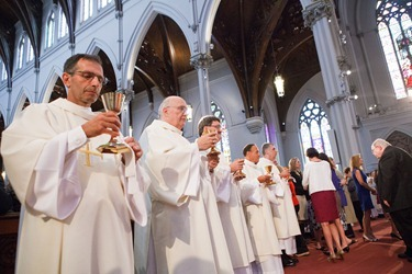 Ordination of Permanent Deacons Robert C. Balzarini, Vincent Gatto, James T. Hinkle, Michael C. Joens, Jonathan Jones, Brian K. Kean, Thomas OShea, Louis J. Piazza, William K. Reidy, and Paulo Torrens, Sept. 22, 2012 at the Cathedral of the Holy Cross. &#10;Pilot photo/ Gregory L. Tracy&#10;
