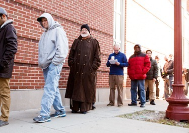 Cardinal Seán P. O'Malley waits in line to vote at Cathedral High School in Boston's South End Nov. 6, 2012.