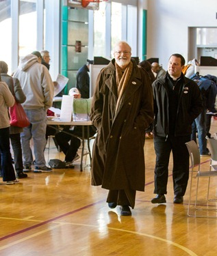 Cardinal Seán P. O'Malley smiles after casting his ballot at Cathedral High School in Boston's South End Nov. 6, 2012.