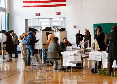 Cardinal Seán P. O'Malley prepares to leave his local polling place at Cathedral High School after casting his ballot Nov. 6, 2012.