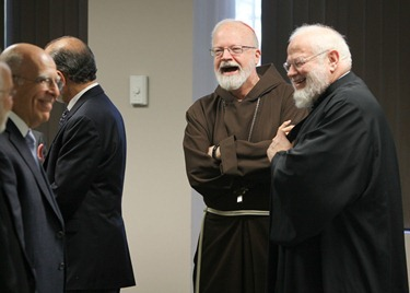 Religious leaders gather after effort on Question 2. Pilot photo/ Gregory L. Tracy