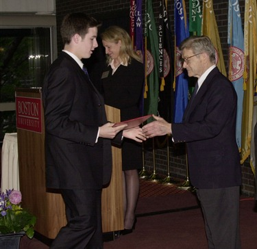Michael D. Dewey, of the  Catholic Memorial High School,   shakes hands with Dr. Silber and Bishop Lennon, as he is presented with his scholarship.                            