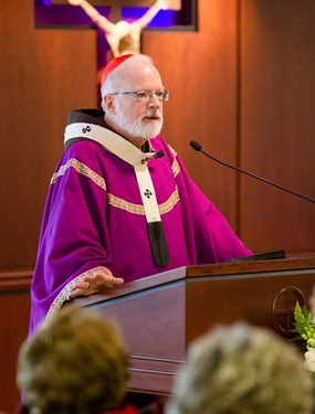 "Cardinal Sean P. O'Malley celebrates a ""month's mind"" memorial Mass for his stepmother Claire O'Malley in the chapel of the Boston Archdiocese's Pastoral Center Feb. 20, 2013. Mrs. O'Malley passed away in Florida on Sunday, Jan. 20 at age 90. Pilot photo by Gregory L. Tracy"