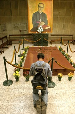 MAN PRAYS AT TOMB OF ARCHBISHOP ROMERO