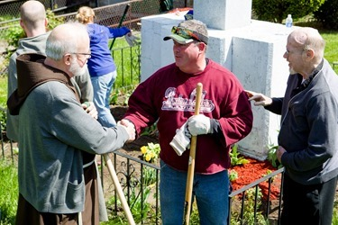 Cardinal Sean P. O'Malley joins archdiocesan employees working to beautify St. Patrick Church in Roxbury as part of Parish Service Week, May 13, 2013. After the spring cleaning, Cardinal Sean visited St. Patrick School spending time with students and with the classmates of Barry Brinson, a 7th grade student at the school who was killed May 9 in a traffic accident in Allston.