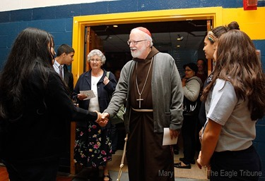 MARY SCHWALM/Staff photo Cardinal Sean P. O'Malley shakes hands with Notre Dame Cristo Rey High School students in they gym at the school after participating in 10th anniversary mass of celebration and thanksgiving at St. Mary's Church in Lawrence.   10/9/13