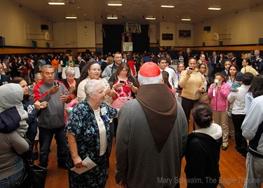 MARY SCHWALM/Staff photo Cardinal Sean P. O'Malley poses for photos for Notre Dame Cristo Rey High School students, family and friends in they gym at the school after participating in 10th anniversary mass of celebration and thanksgiving at St. Mary's Church in Lawrence.   10/9/13