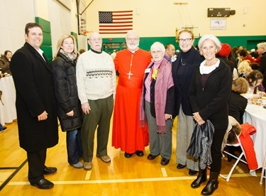Cardinal Seán P. O'Malley greets Cheverus Award recipients and their guests at a reception at Cathedral High School following the Nov. 24, 2013 Cheverus Award ceremony.