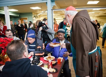 Cardinal Seán P. O'Malley, Boston Mayor-elect Marty Walsh and Sen. Edward Markey serve meals at Pine Street Inn Dec. 24, 2013. Pilot photo by Gregory L. Tracy