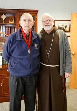 John McNeice receives his Cheverus Award from Cardinal Seán P. O'Malley Apri 8, 2014. Pilot photo/ Gregory L. Tracy