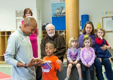 The 2014 Boston Marathon Men's winner Meb Keflezighi visits Catholic Charities' Laboure Center in South Boston May 15, 2014. (Pilot photo/ Christopher S. Pineo)