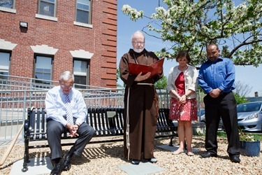 Dedication of a bench in honor of former Boston Mayor Thomas Menino outside Catholic Charities' Teen Center at St. Peter's in Dorchester May 12, 2014.   Pilot photo/ Gregory L. Tracy