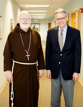 Ambassador Jeffrey DeLaurentis meets with Cardinal Sean P. O'Malley in the cardinal's Braintree office Aug. 14, 2014. Pilot photo/ Gregory L. Tracy