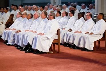 Cardinal Seán P. O'Malley ordains 13 men as permanent deacons at the Cathedral of the Holy Cross Sept. 20, 2014. The newly ordained are: Deacons Francis X. Burke, Michael F. Curren, William A. Dwyer, George C. Escotto, Edward S. Giordano, Charles A. Hall, Franklin A. Mejia, Eric T. Peabody, Jesús M. Pena, Álvaro José L. Soares, Michael P. Tompkins, Jude Tam V. Tran, and Carlos S. Valentin.<br /> Pilot photo/ Gregory L. Tracy<br />