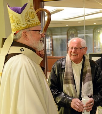 Cardinal with Deacon Mannion after Mass