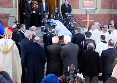 Mourners gather outside Most Precious Blood Church in Hyde Park for the Funeral Mass for former Boston mayor Thomas M. Menino Nov. 3, 2014.  The former mayor died Oct. 30 just week after announcing that he was suspending his treatment for cancer.&lt;br /&gt;<br /> Pilot photo/ Christopher S. Pineo&lt;br /&gt;<br />