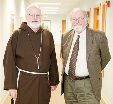 Cardinal Sean P. O'Malley is pictured with retiring archivist of the Archdiocese of Boston, Robert Johnson-Lally in the cardinal's offices, Jan. 7, 2015. Johnson-Lally retired Dec. 31, 2014 after serving the archdiocese from more than 20 years.
