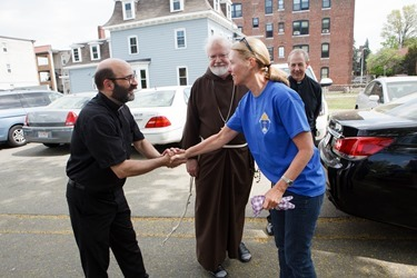 Cardinal Sean O'Malley visits those participating in the Pastoral Center's Parish Service Week at St. Mary of the Angels Parish in Roxbury May 11, 2015. Pilot photo/ Gregory L. Tracy&lt;br /&gt;<br />