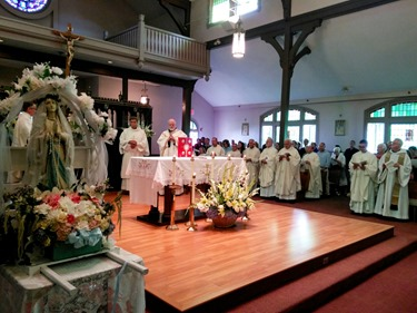 A Mass and festival was held Aug. 9, 2015 at St. Mary of the Assumption in Hull to mark three special occasions of the parish: the 5th anniversary of their feast day celebration, the 125th anniversary of the parish and the 100th anniversary of their church. 