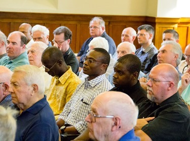 "Boston clergy share priestly fraternity in a casual setting at the Annual St. John Vianney Cookout hosted by St. John Seminary, Aug. 6, 2015. The gathering began with a talk on the papal encyclical ""Laudato Si'"" by Father J. Bryan Hehir.